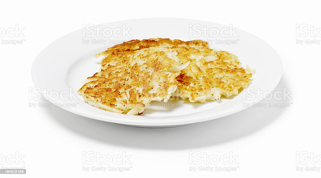 Potato pancakes in a dish on a white background stock photo