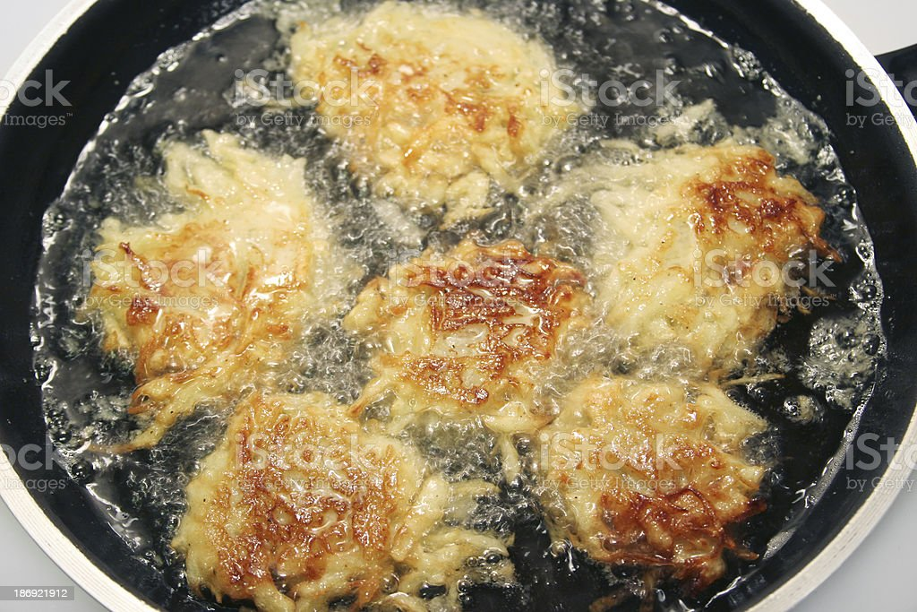 Potato Pancakes - Latkes Frying in Oil stock photo
