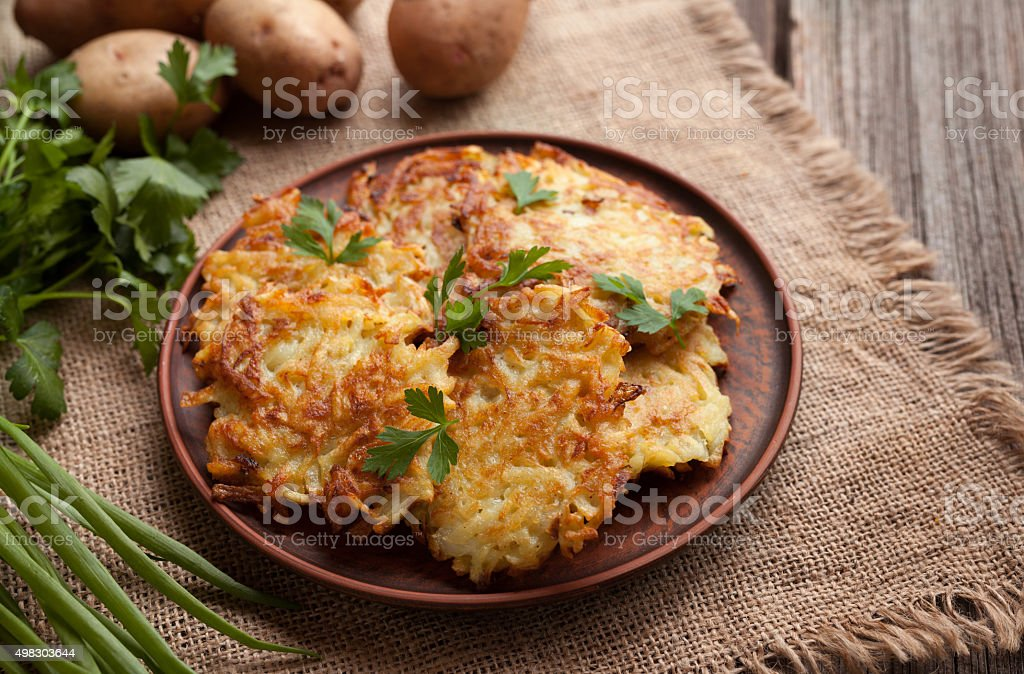 Potato pancakes or latke traditional homemade fried vegetable food recipe stock photo