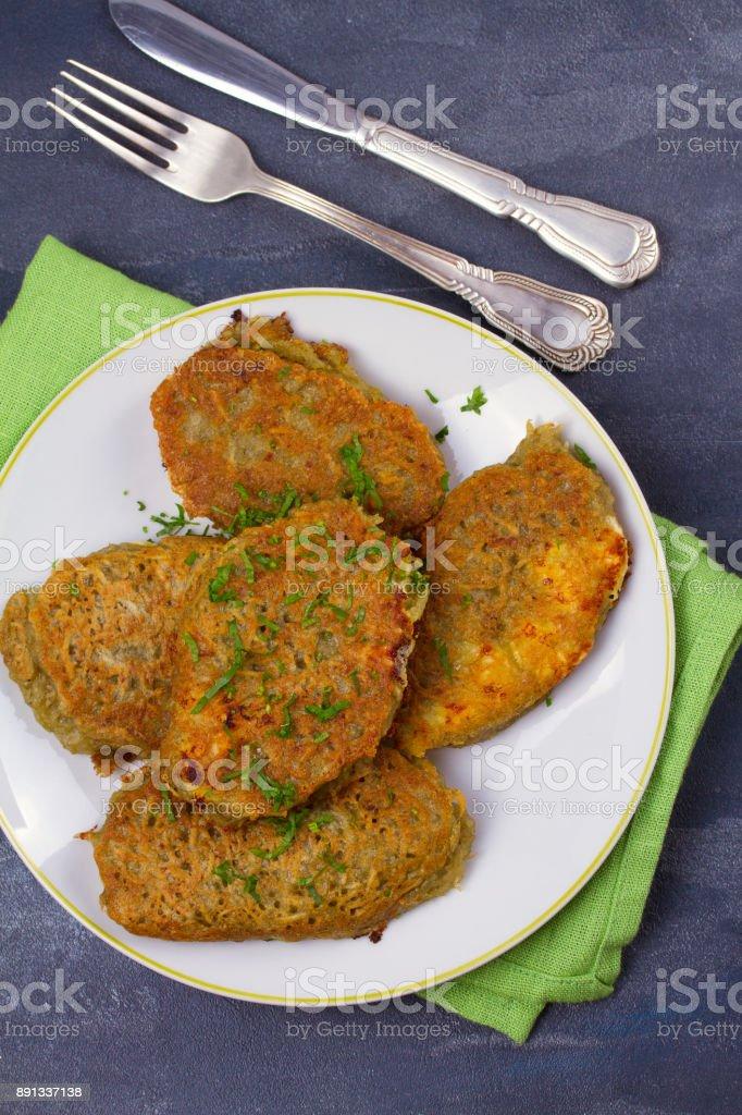 Potato Pancakes. Vegetable fritters. Latkes on a plate stock photo