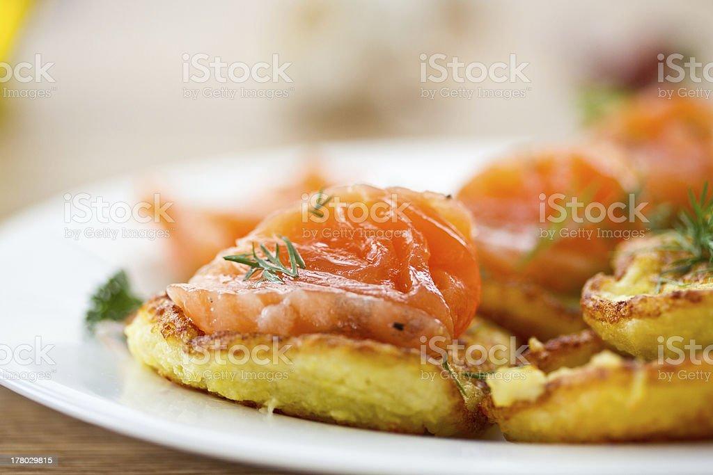 potato pancakes with salted salmon stock photo