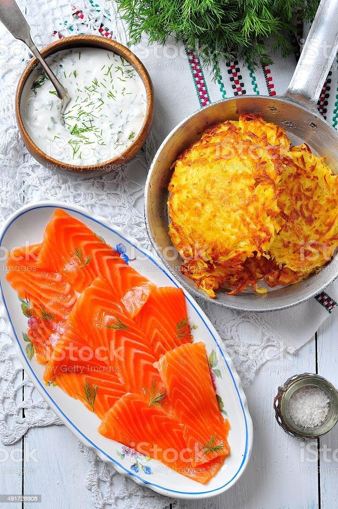 potato pancakes with sour cream and smoked salmon stock photo
