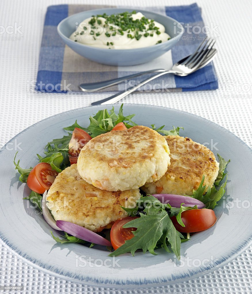 potato patties with salad stock photo