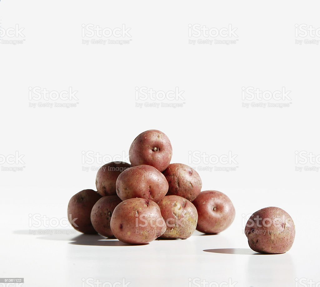 Potato Pile and Lone Spud royalty-free stock photo