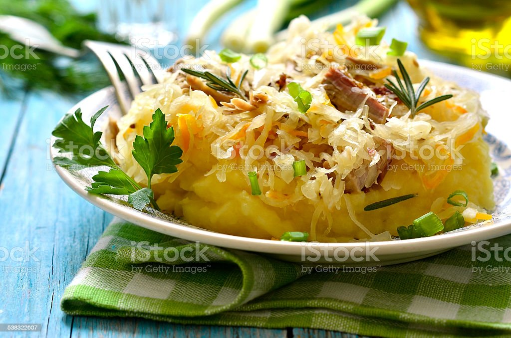 Potato puree garnished with stewed sour cabbage. stock photo