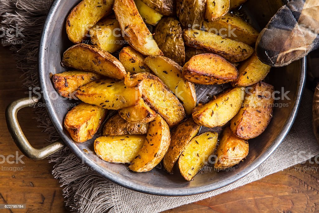 Potato. Roasted potatoes. American potatoes with salt pepper and cumin. – Foto