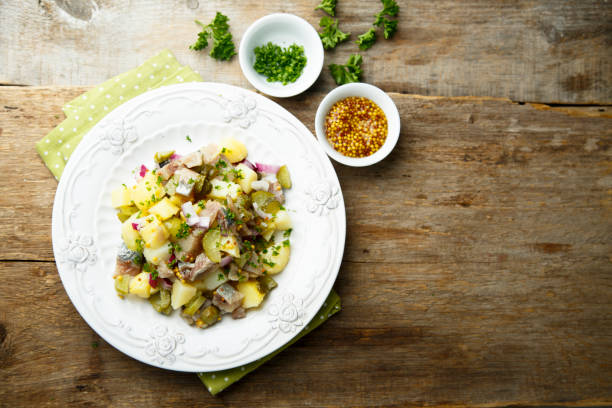 potato salad with herring - herring stock photos and pictures