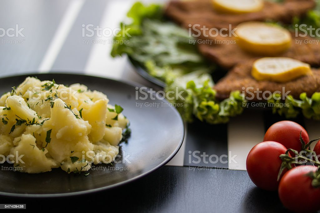 potato salad with schnitzel at restaurant. stock photo