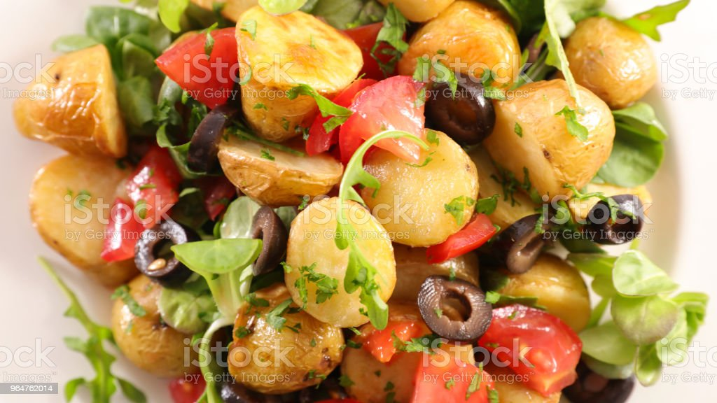 potato salad with tomato and olive royalty-free stock photo
