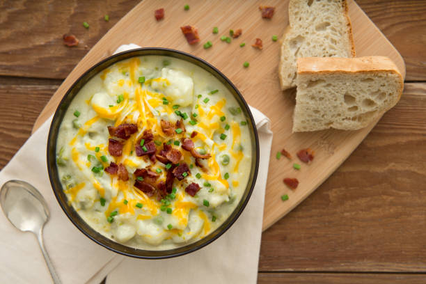 potato soup place setting - knödel kochen stock-fotos und bilder