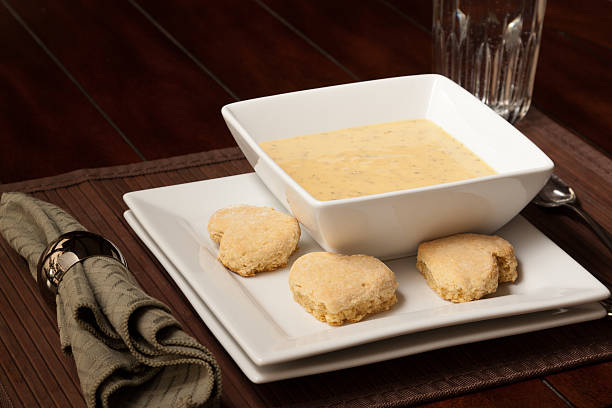 Potato soup with bisquits stock photo