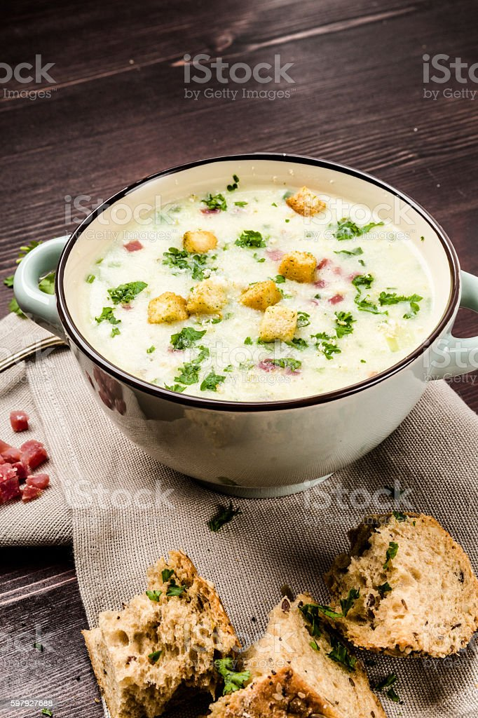 Potato soup with ham and bread stock photo