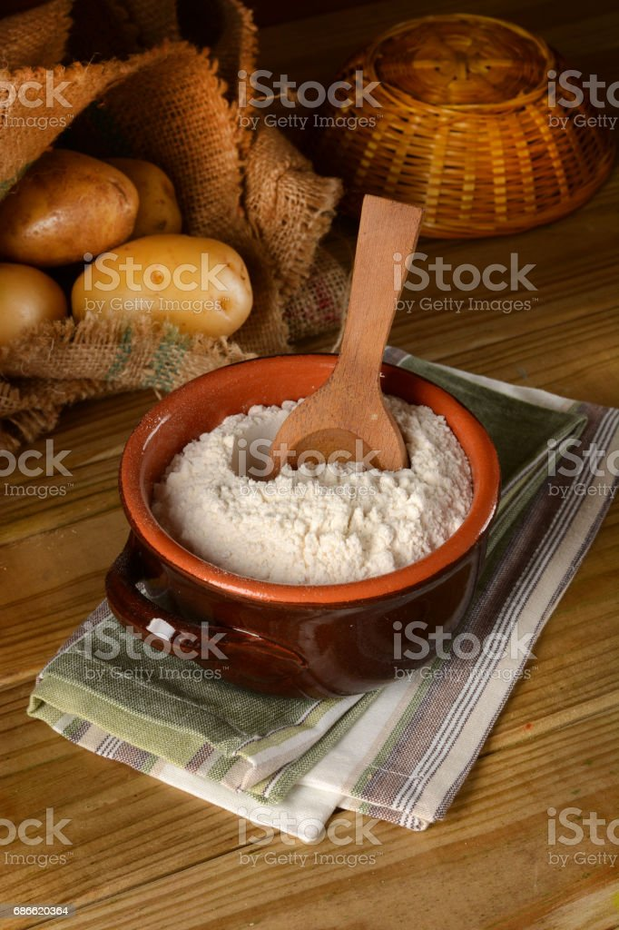 potato starch in terracotta bowl - closeup royalty-free stock photo