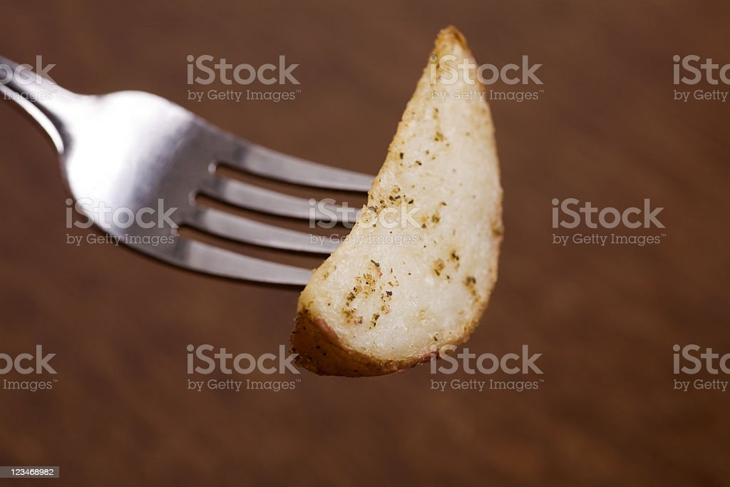 potato wedge on a fork royalty-free stock photo