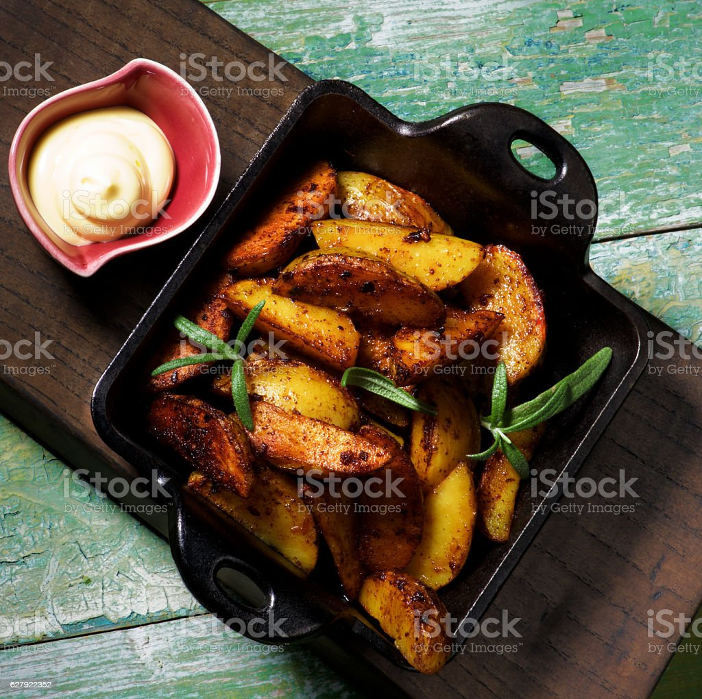 Potato Wedges and Cheese Sauce stock photo