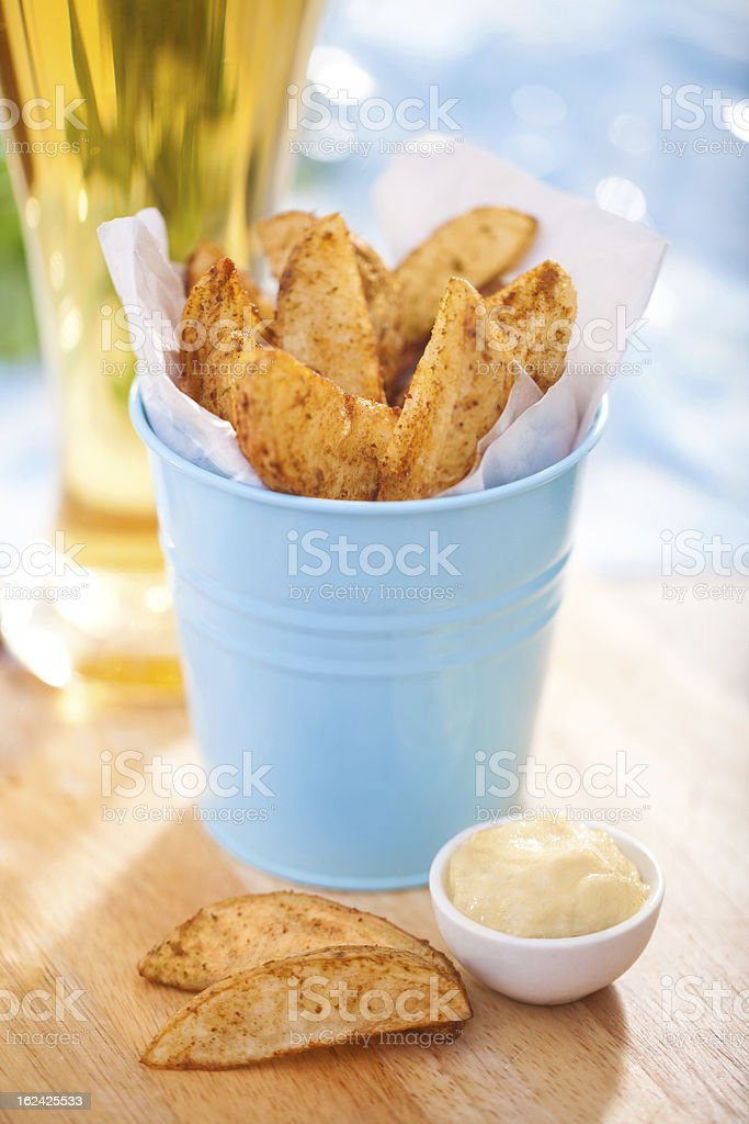 Potato wedges in a bucket stock photo
