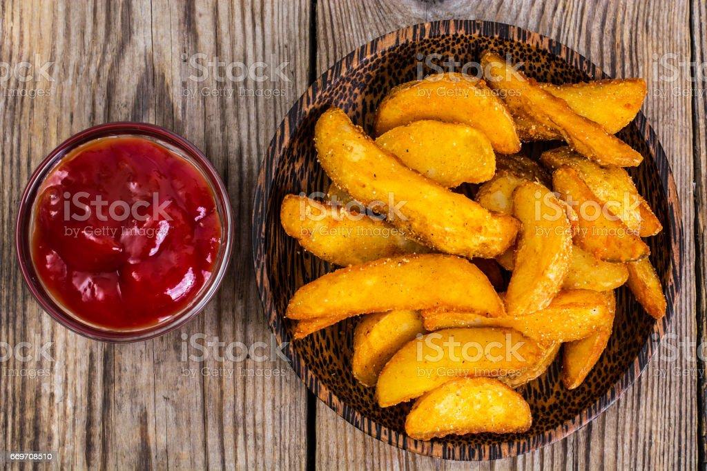 Potato wedges in rural stock photo