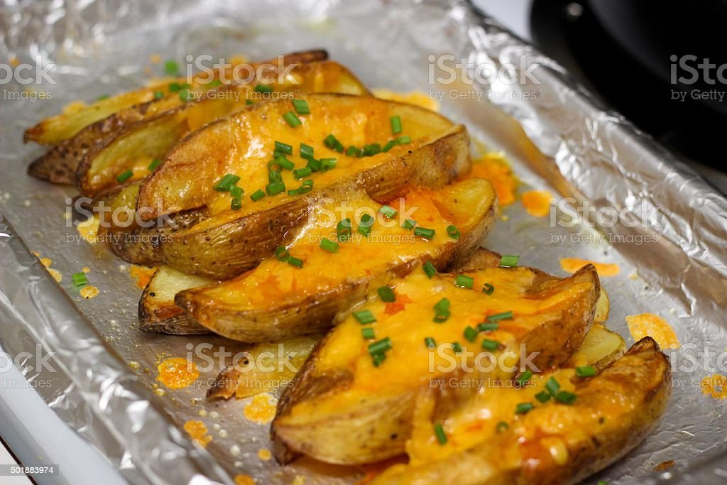 Potato Wedges with Cheese stock photo