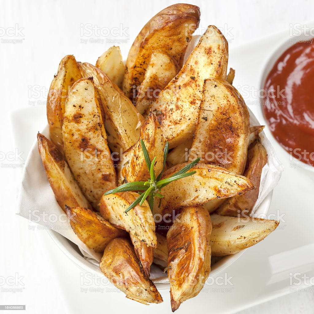 Potato Wedges with Rosemary and Ketchup stock photo