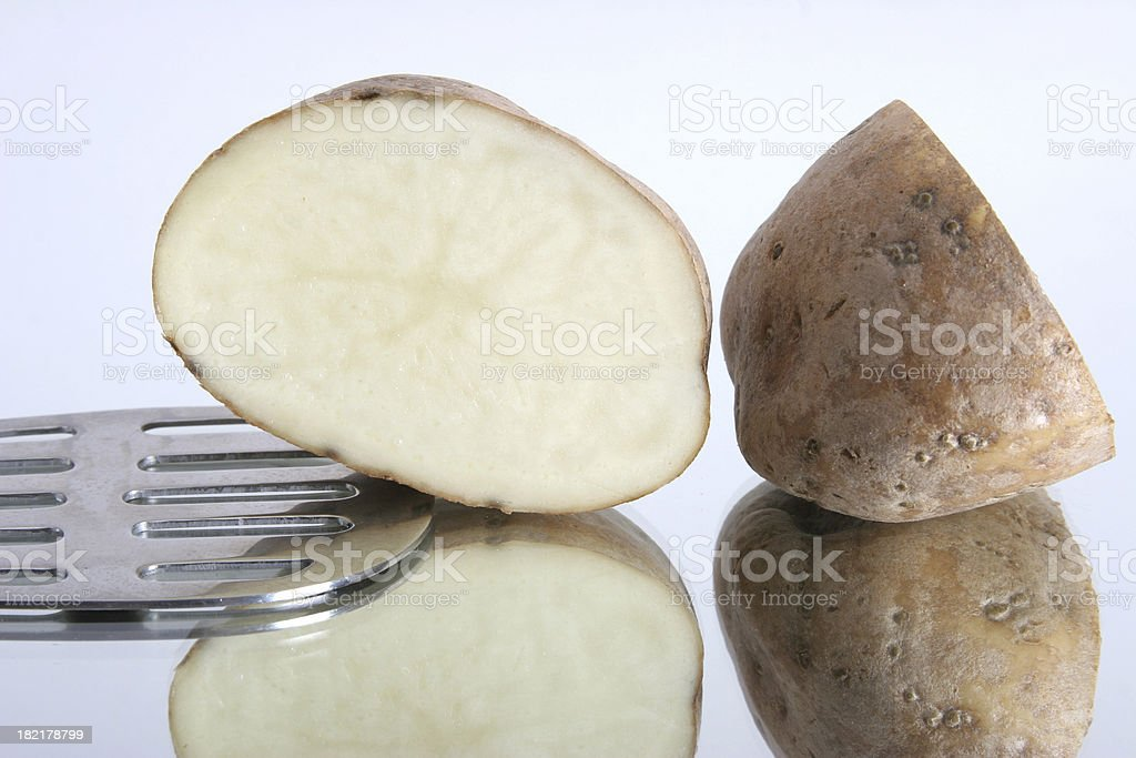 potato with masher close up royalty-free stock photo