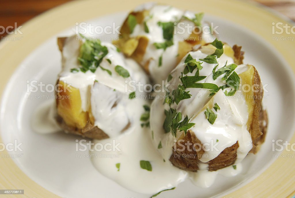 Potatoes baked in foil with sour cream and dill royalty-free stock photo