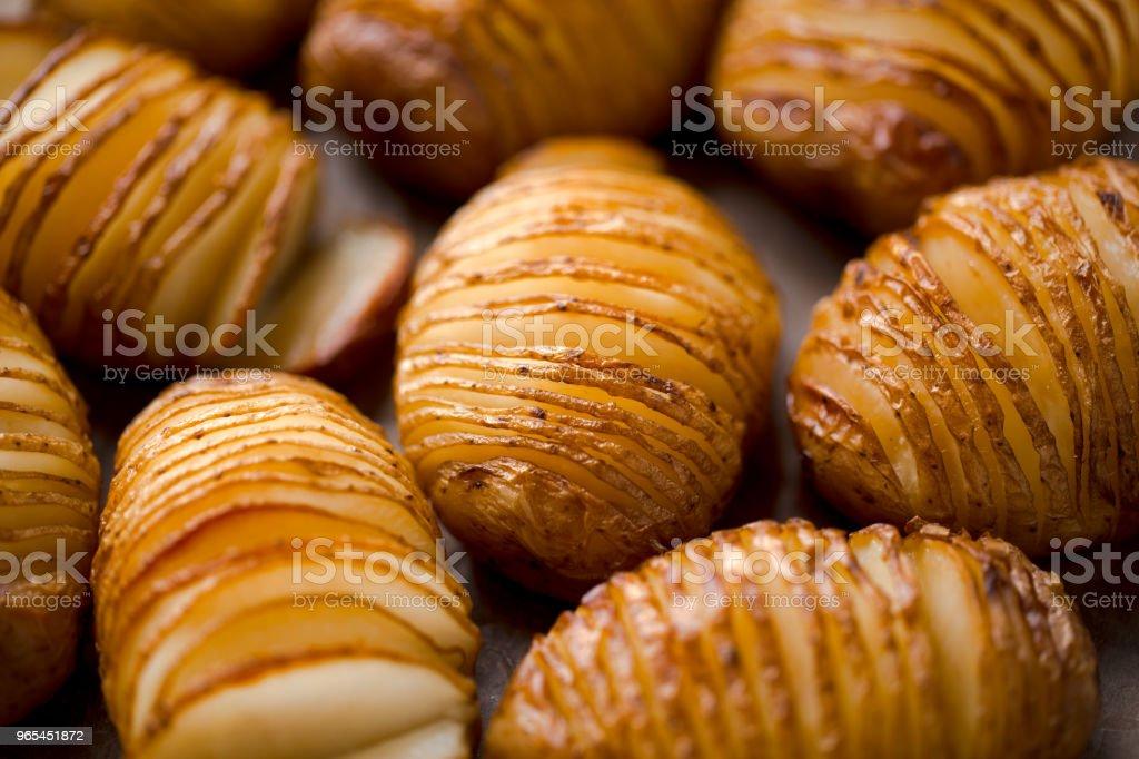 Potatoes baked in stripes. zbiór zdjęć royalty-free
