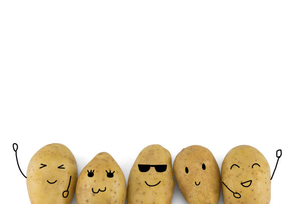 Potatoes cartoon characters isolated on white stock photo
