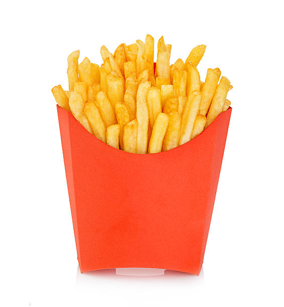 potatoes fries in a red carton box isolated. fast food. - friet stockfoto's en -beelden