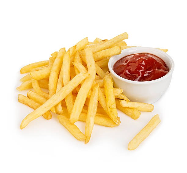 Potatoes fries with ketchup close-up isolated on a white background. stock photo