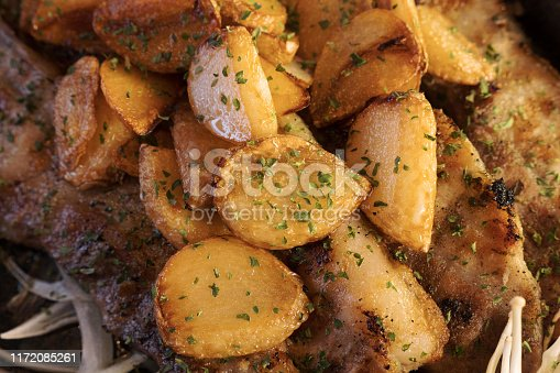 potatoes from the oven with parsley close-up