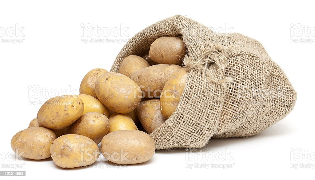 potatoes in a burlap bag stock photo