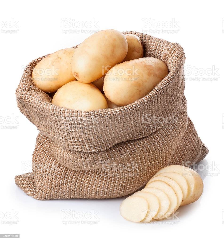 potatoes in burlap bag with sliced potato beside isolate royalty-free stock photo
