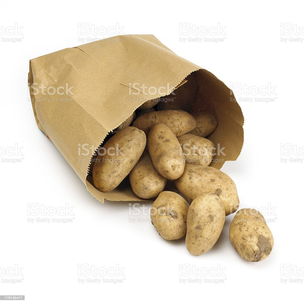 Potatoes in paper bag royalty-free stock photo