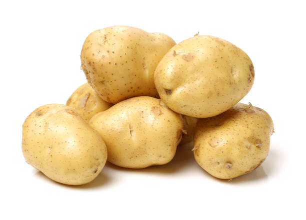 Potatoes on the white background stock photo