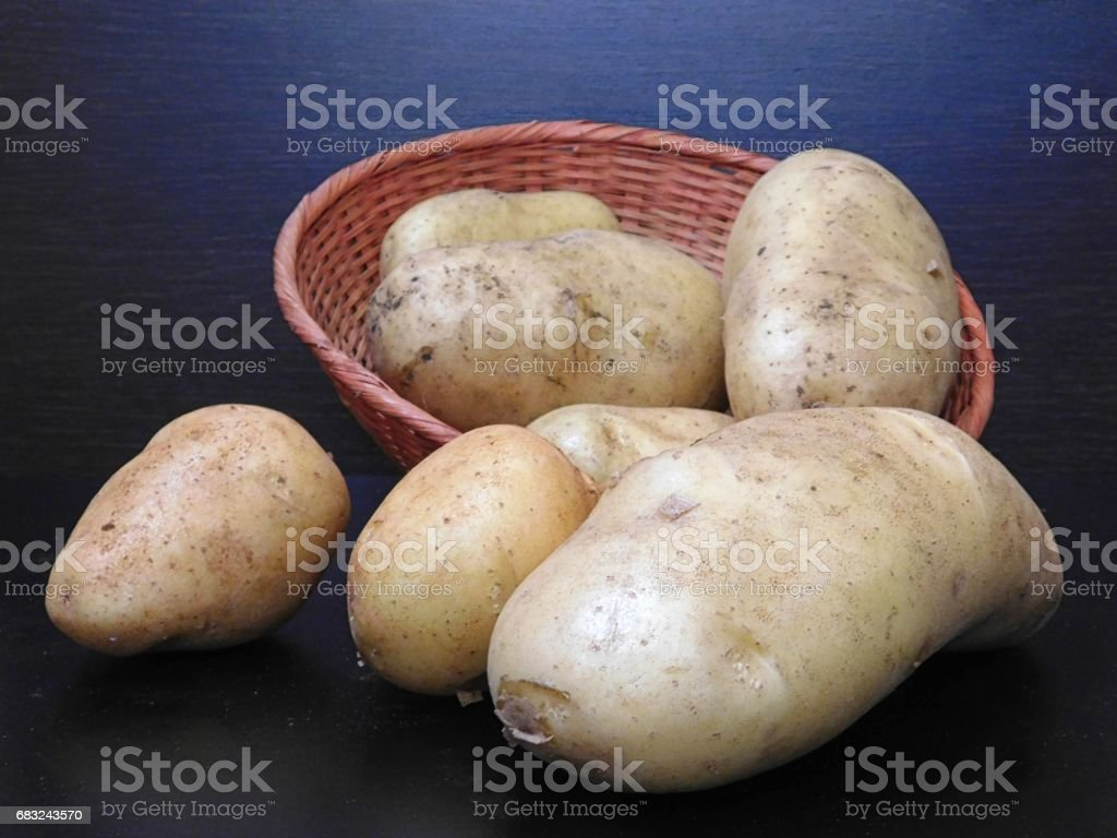 Potatoes on wooden background royalty-free 스톡 사진