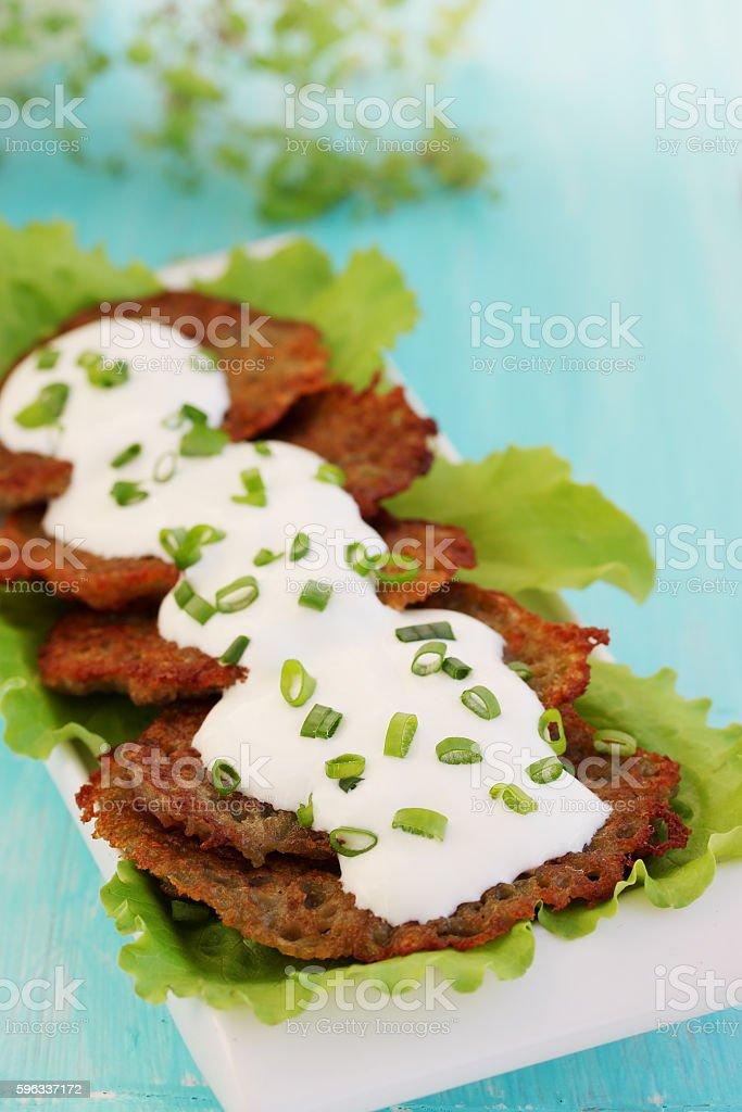 Potatoes pancakes with sour cream royalty-free stock photo