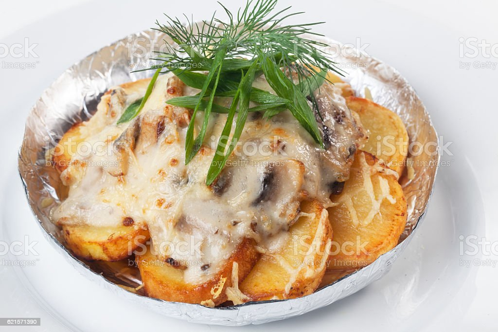 potatoes with mushrooms in foil isolated white background mayonnaise cheese photo libre de droits