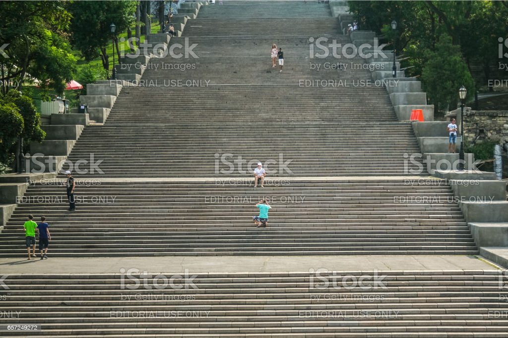ODESSA, UKRAINE - AUGUST 6, 2014: Potemkin stairs with people posing on them. The Odessa stairs, that have been picture in the famous Soviet movie Potemkin, are a major landmark of this Ukrainian city stock photo