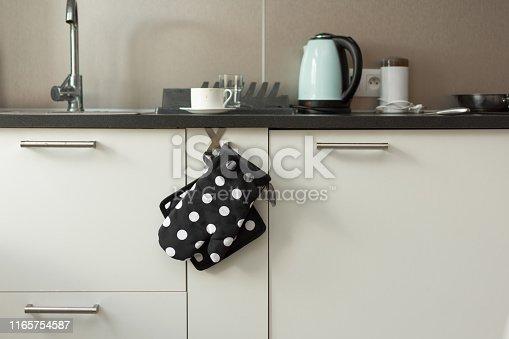 839034546 istock photo Potholder and an oven mitt in modern kitchen interior. 1165754587