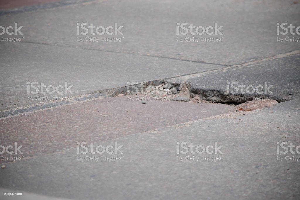 pothole in road stock photo