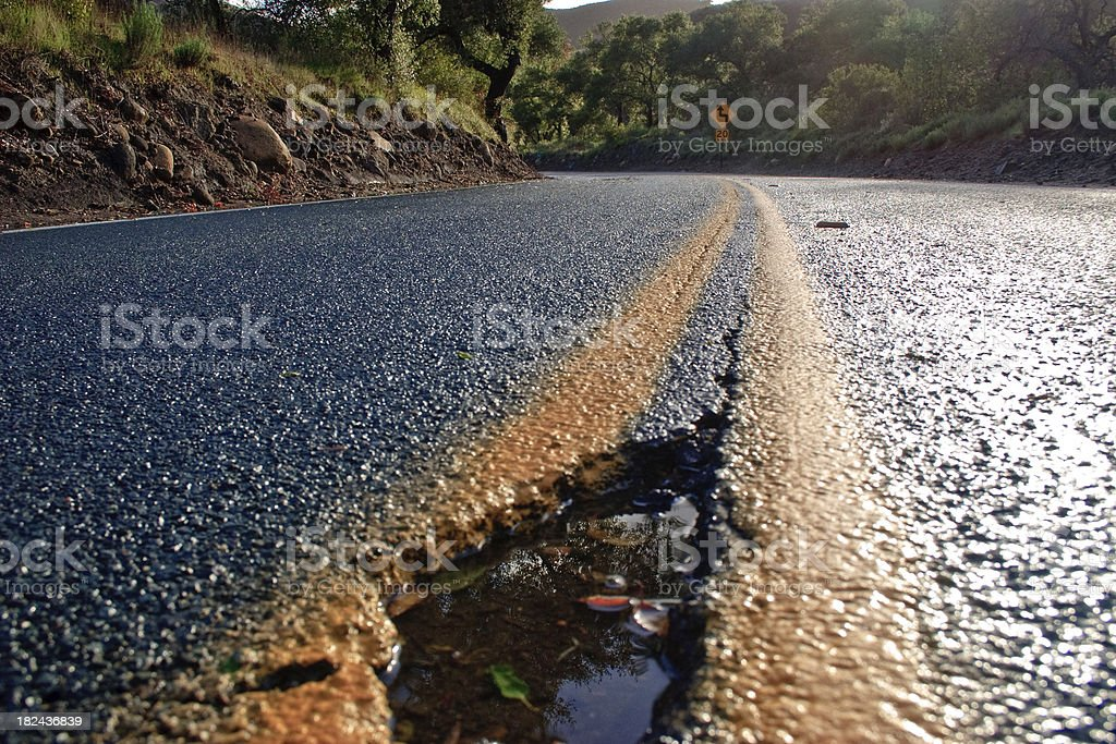 Pothole in the road stock photo