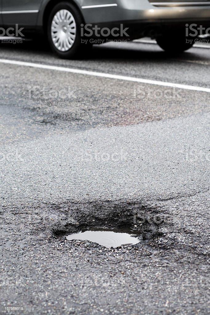 Pothole royalty-free stock photo