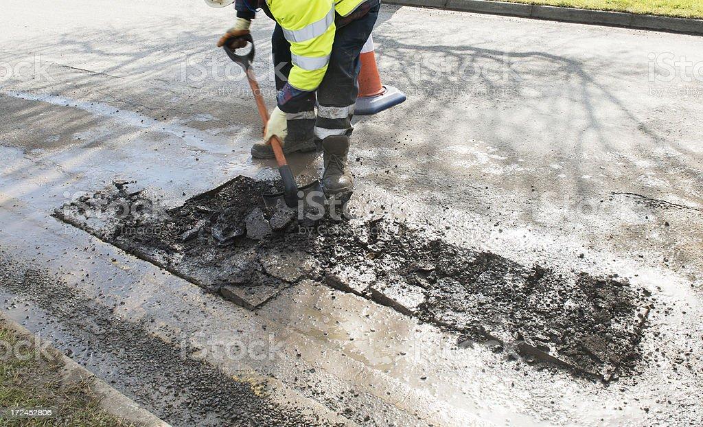 pothole repair in progress stock photo
