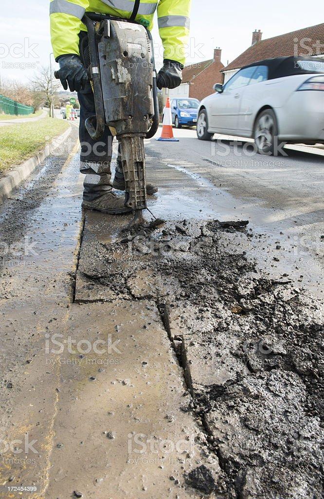pothole rpairs with jackhammer stock photo