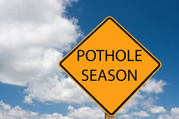 pothole sign stock photo