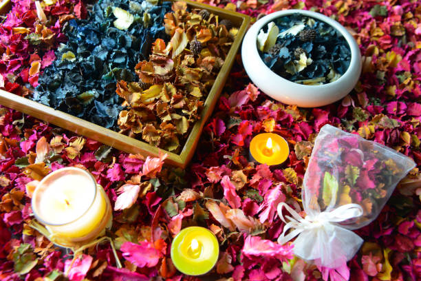 Potpourri or dried petals flowers colorful and scented candles stock photo