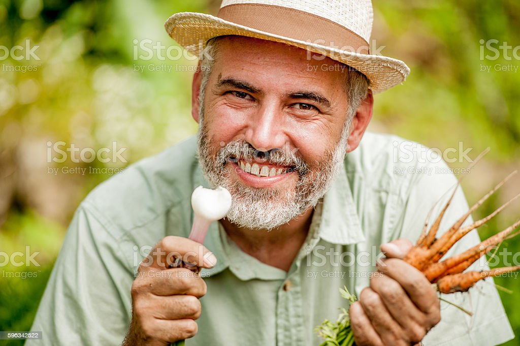 Potrait of Farmer Holding Vegetable royalty-free stock photo