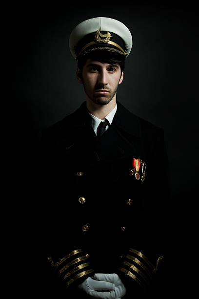 Potrait of Male Navy Ship Captain, Isolated on Black stock photo