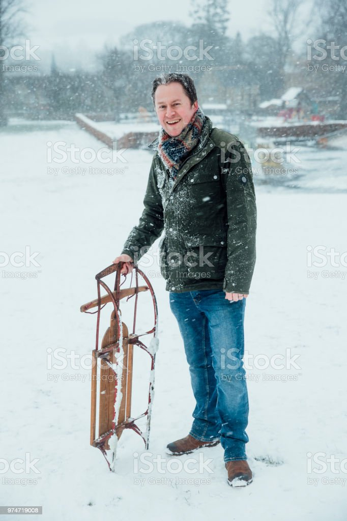 Potrait of Man with Sleigh stock photo