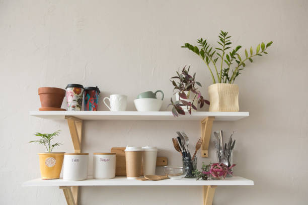 Pots and dishware on shelves stock photo